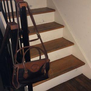 Dooney  and Bourke black w/brown trim leather bag